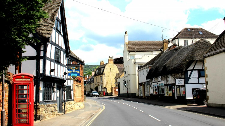 The High Street, Prestbury, Gloucestershire - on the left is 'The King's Head'.  On the right is the old Post Office.